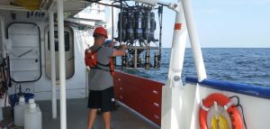 A scientist from the Louisiana Universities Marine Consortium deploys a water sensor to collect samples for testing oxygen levels in the Gulf of Mexico.