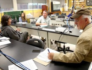 Doug Daigle, a research associate of Louisiana State University's Department of Oceanography and Coastal Sciences and coordinator of the Louisiana Hypoxia Working Group (far right), takes notes today during a meeting on the Nicholls State University campus. [Abby Tabor/Staff -- dailycomet/houmatoday]