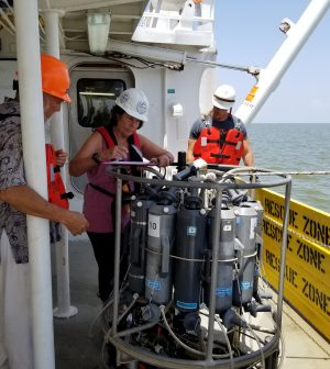 Dr. Nancy Rabalais and members of the LUMCON team prepare to deploy a Sea-Bird Scientific SBE 32 carousel water sampler with a CTD into the Gulf of Mexico. (Credit: LUMCON)