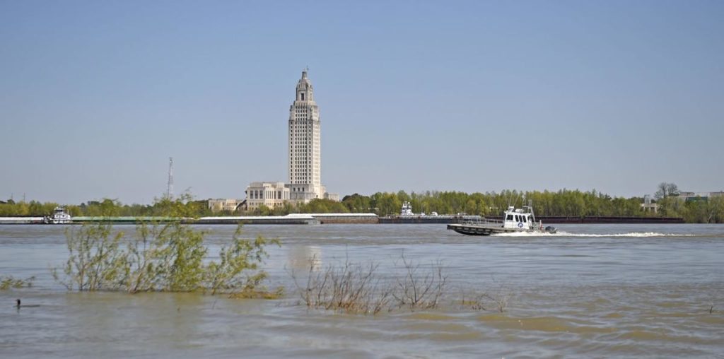 The Mr. Andre', a DAL-CO Marine Services supply boat, passes in front of the Louisiana State Capitol, seen across the Mississippi River from the Old Ferry Landing in Port Allen, Wednesday, March 20, 2019. (Advocate staff photo by HILARY SCHEINUK)